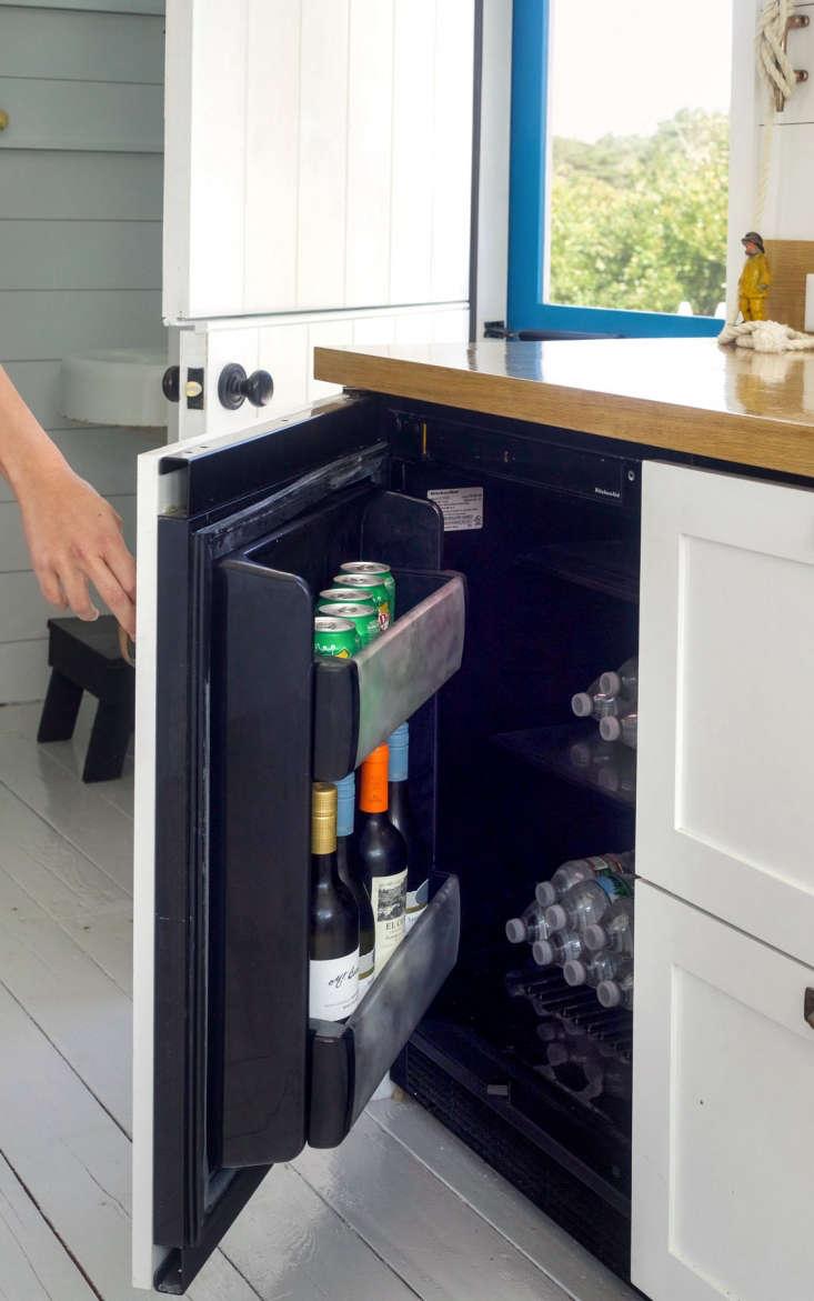 A Kitchenaid 24-Inch Panel Ready Undercounter Refrigerator serves as a mini drinks refrigerator.