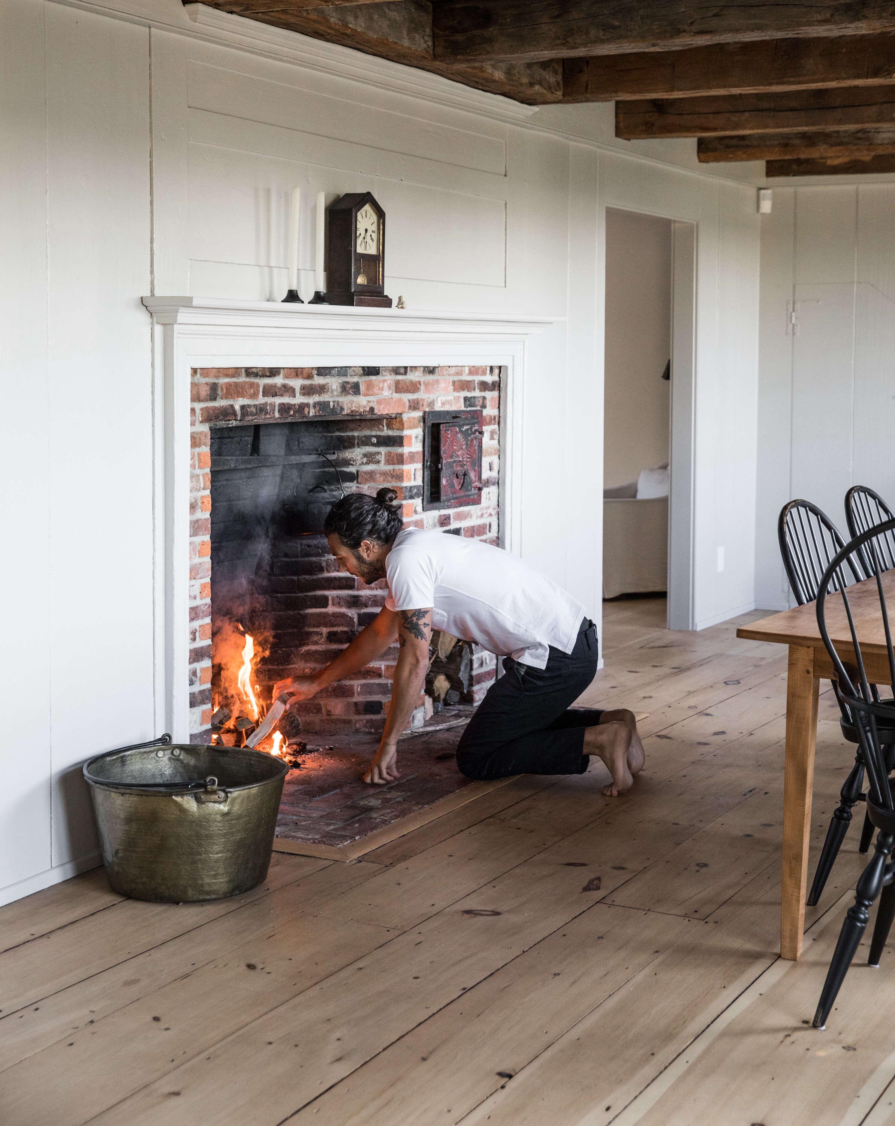 anthony esteves maine cape living room fireplace greta rybus cover   cropper