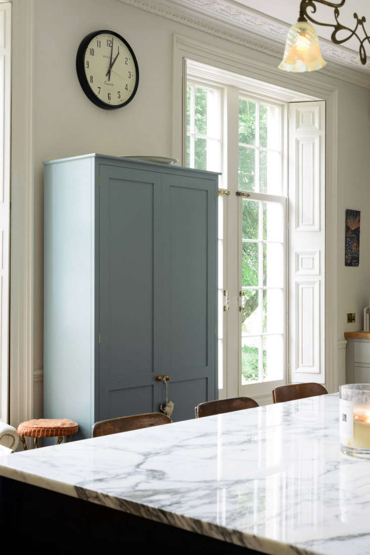 Blue custom cabinet in quirky English Country kitchen by deVol for Pearl Lowe