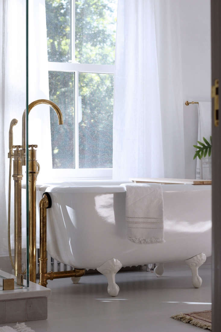 Clawfoot bathtub with brass fixture in a master bath remodel in Rockport, Maine, by Jersey Ice Cream Co.