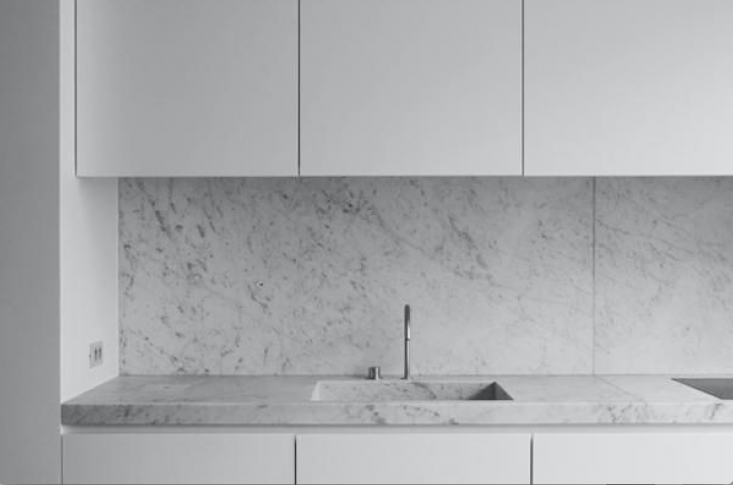 A Carrara marble counter—and integrated sink—in the JR Loft in Brussels byNicolas Schuybroek. See more atTrend Alert: 14 Integrated Marble Kitchen Sinks.