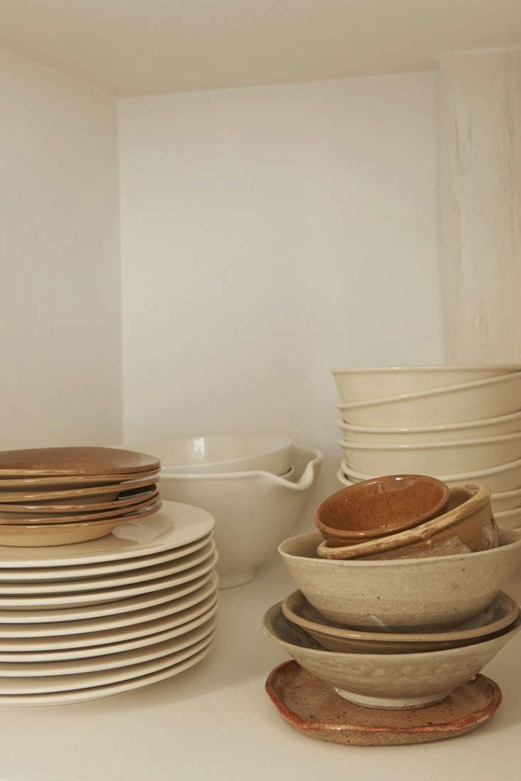 The couple's collection of dishware includes both handmade ceramic dishes and Rainbow Plates from Hay.