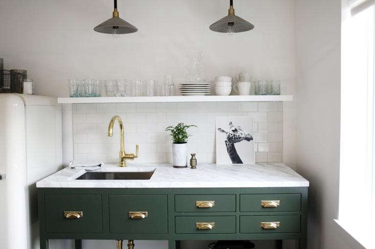 Even a petite kitchenette, like this one in a Seattle office, can accommodate a sink suitable for washing dishes and hands. For more sinks in tiny kitchens, seeTrend Alert: 20 Well-Designed Kitchenettes.Photograph byBelathée Photographyand courtesy ofH2 Design + Build, fromKitchen of the Week: A Before & After Office Rental in Seattle.