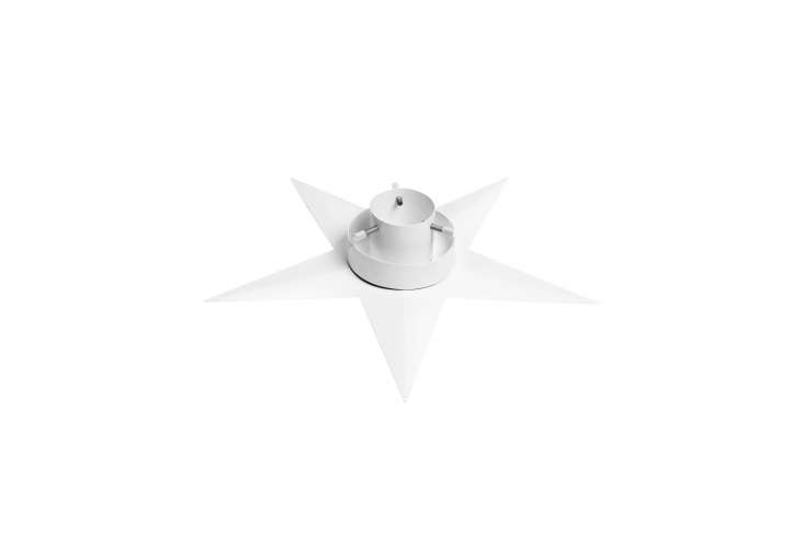 TheChristmas Tree Stand designed by Maria Haard for Design House Stockholm is available in white from Vålamagasinet for \1,\295 SEK (\$\153 USD).