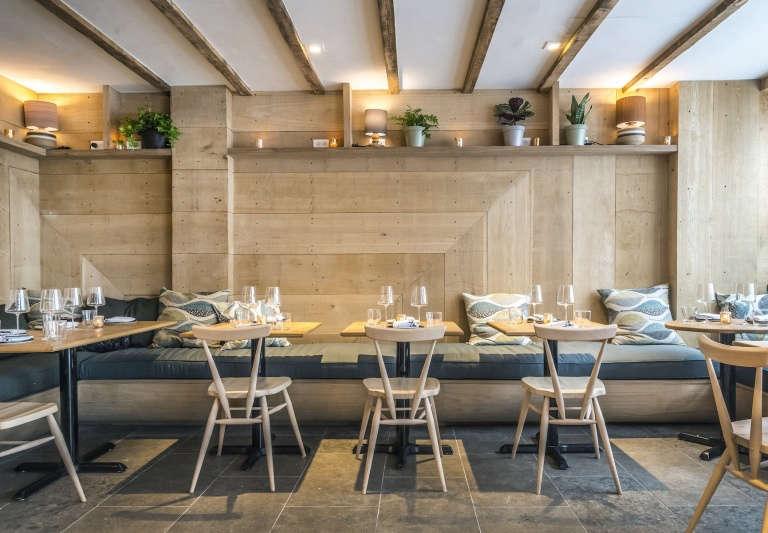 ferris restaurant interior nyc pale wood blue cushions