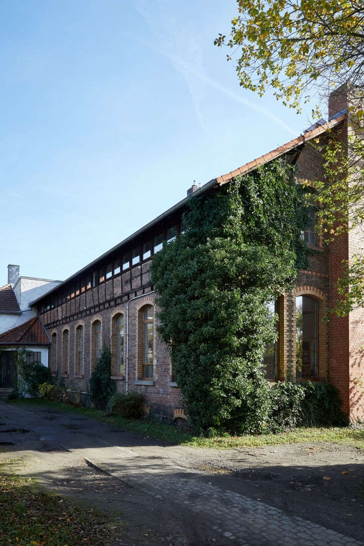 the building is made of multicolored brick with a band of clerestory windows ov 28