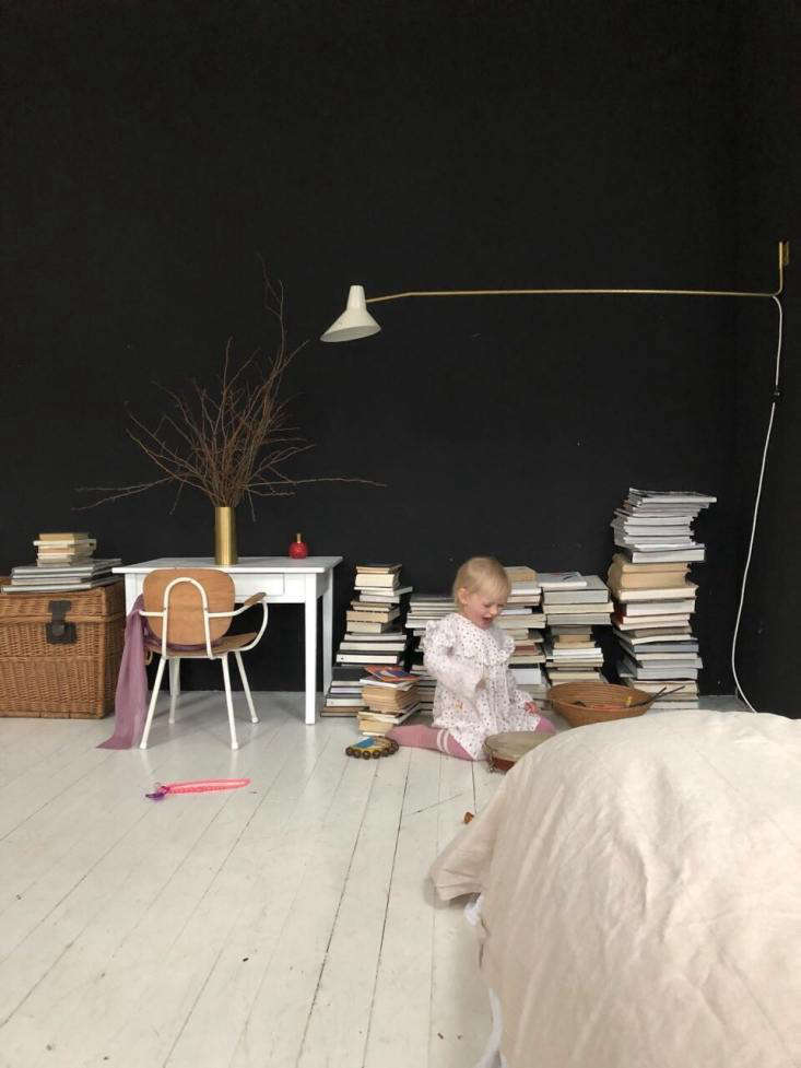 maria at play in her older sister&#8\2\17;s room with a moody blue wall ( 21