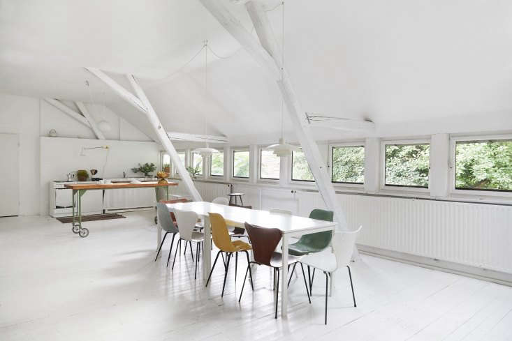 the extra long table—two joined ikea dining tables—is surrounded by arne ja 11