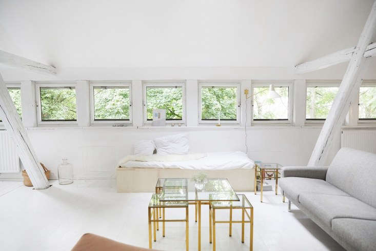 a homemade birch ply daybed and midcentury sofa anchor the living area. the bra 17