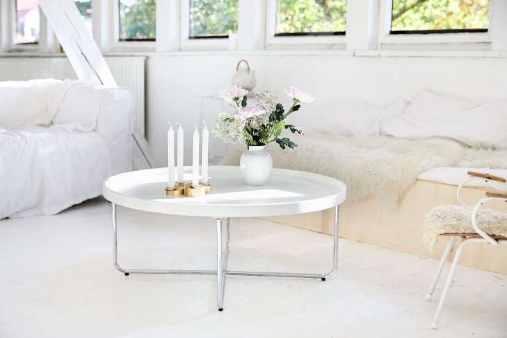 the new coffee table is a round design from the seventies. the white loveseat i 18
