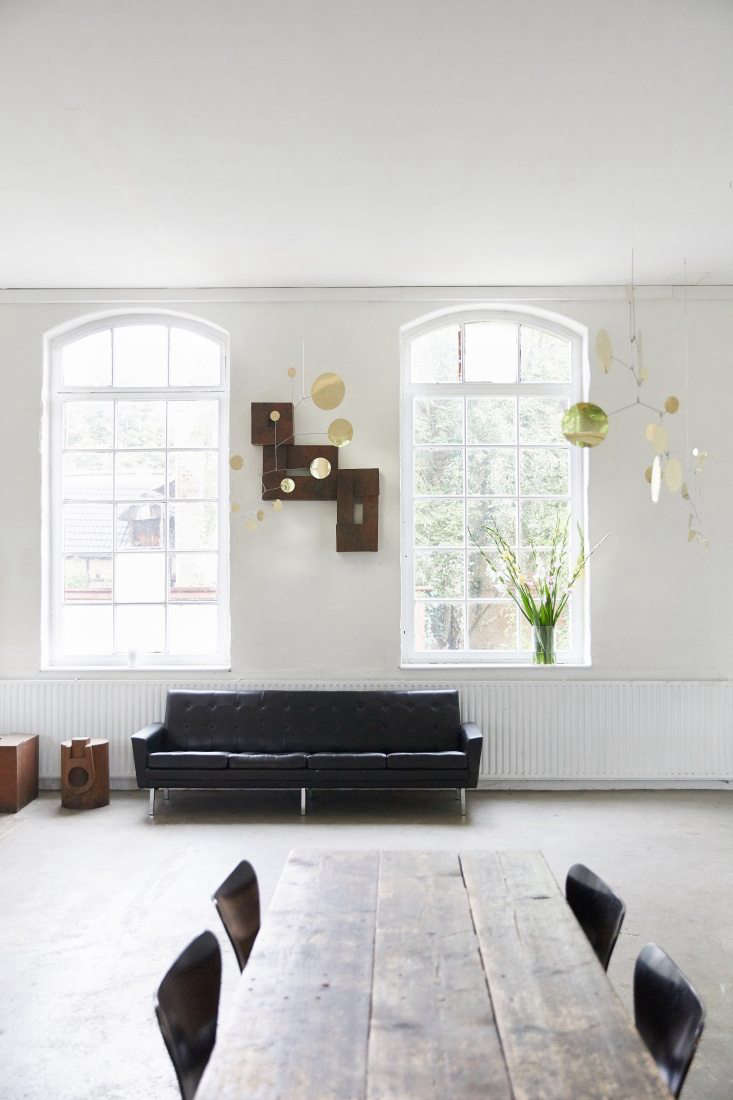above: a \1960s black leather sofa, flat files, and lappalainen brass mobiles. 24