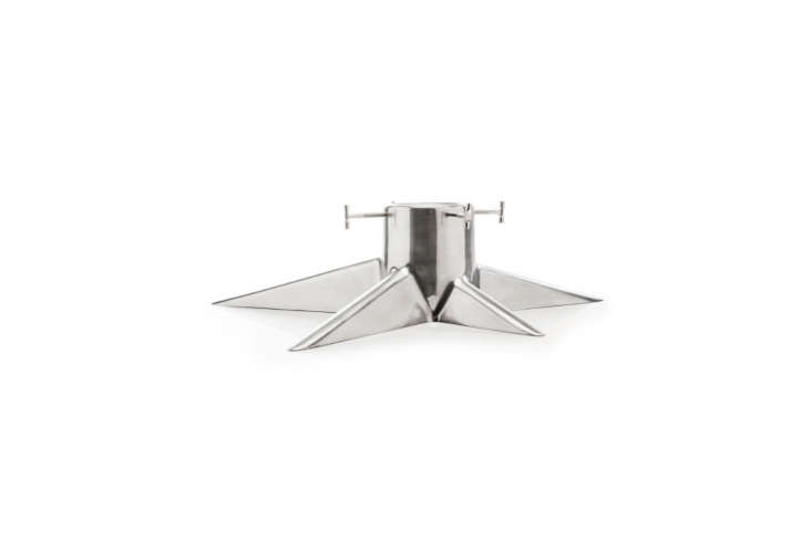TheRoot Christmas Tree Stand in lightweight aluminum is \$\294 at Royal Design. It also comes in shiny white, shiny black, and matte black.