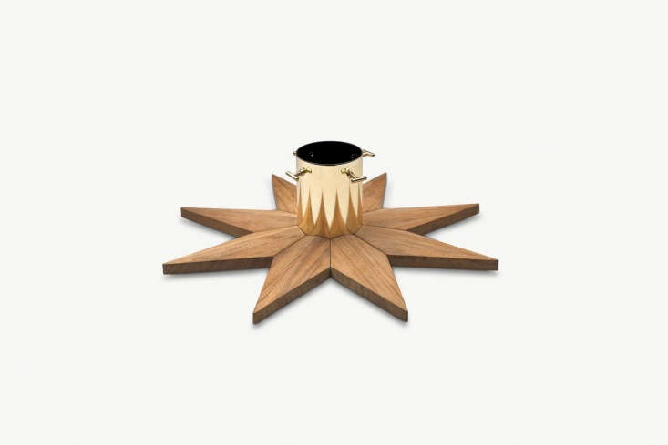 Danish company Skagerak makes a Christmas Tree Base from teak and brass-plated steel; €\279 (\$330) at Skagerak. Also available at Viesso (\$3\29) and Decor Interiors (\$349) in the US.