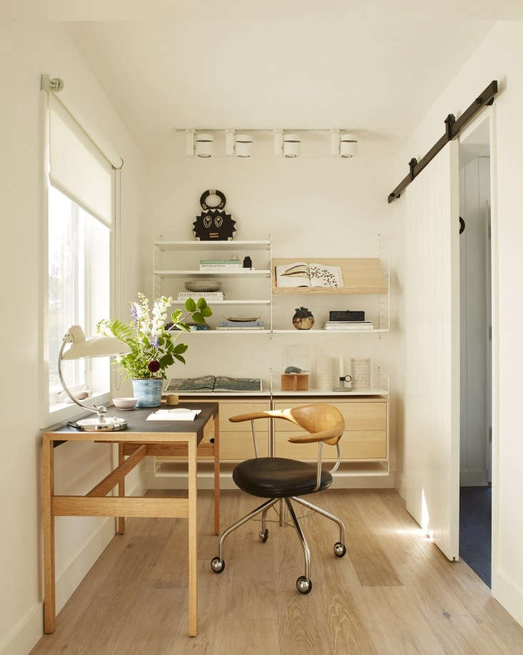 wall mounted string shelving provides both open and closed storage options in t 12