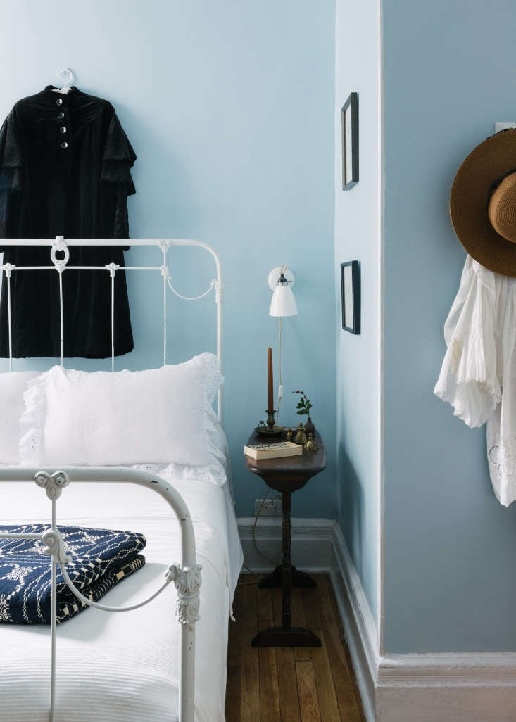 a rust candle by the bedside adds just enough color. photograph by jonathan pil 21