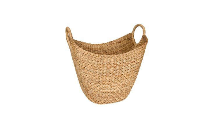 a woven seagrass basket with handles stores hammam style striped beach towels i 11