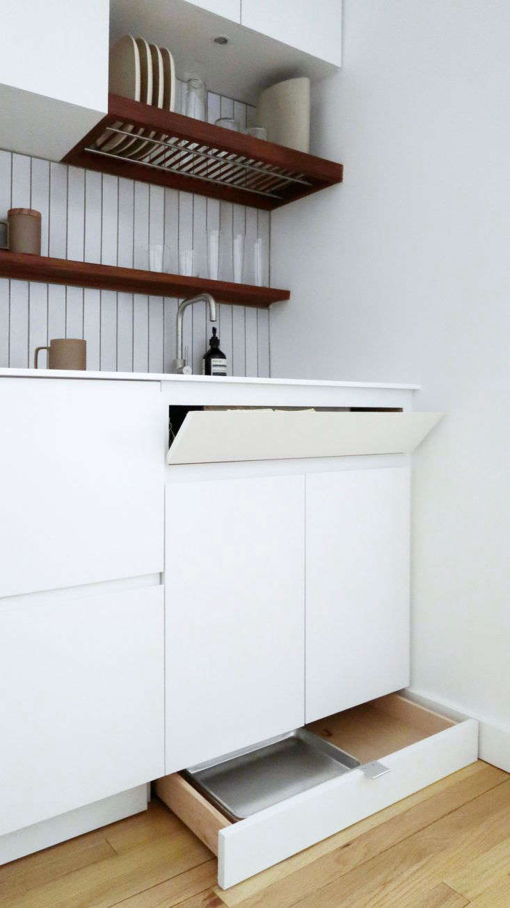 Toe kicks can also be an opportunity for clever added storage, as seen inA Tiny Kitchen Made for Cooking: Everything You Need in 26 Square Feetover on The Organized Home.