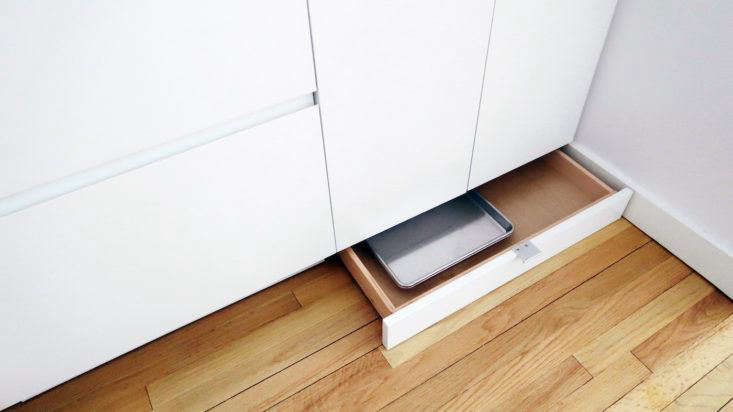 The cabinet toe kicks are drawers for storing shallow items like pans, cutting boards, and baking racks.