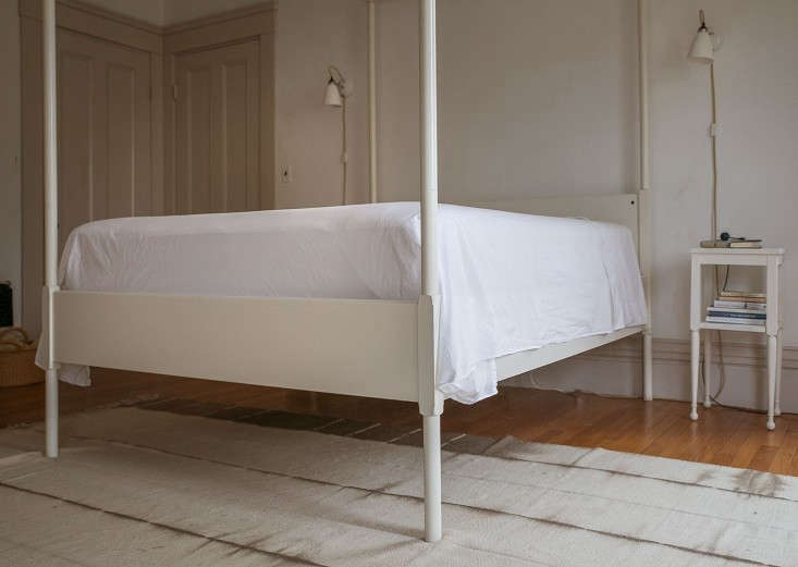 The top sheet is securely tucked in at the foot of the bed.