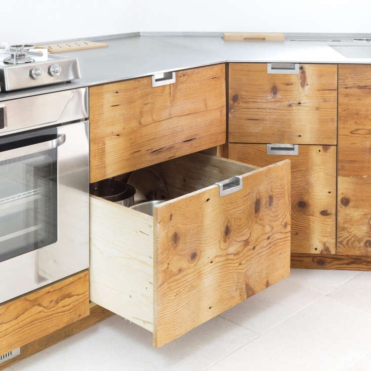Wood drawers in an Italian kitchen made of reclaimed larch wood