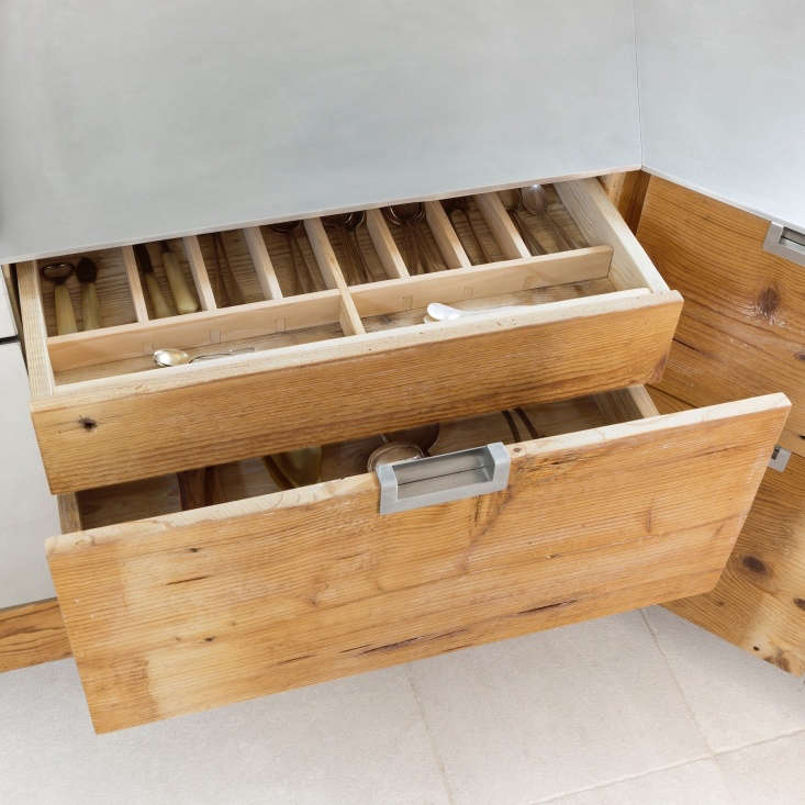 Wood flatware organizer drawer in an Italian kitchen made of reclaimed larch wood