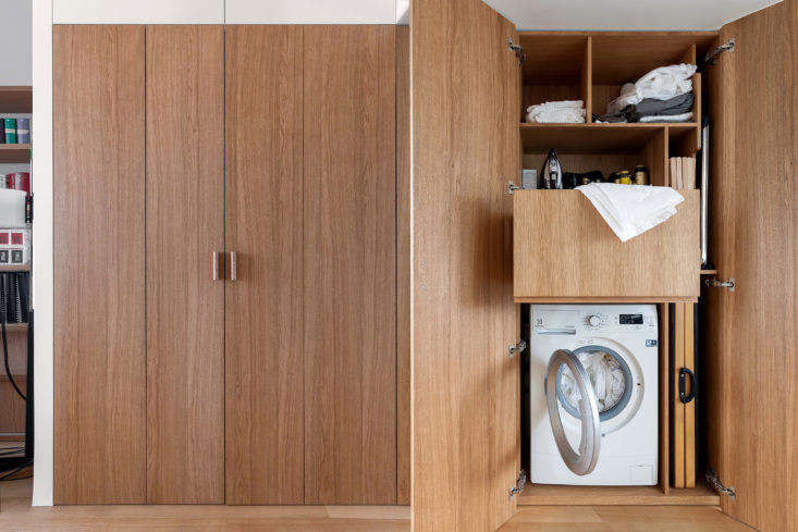 In a normal apartment, this wall of doors might simply reveal clothes closets; in this 355-square-foot home, you&#8