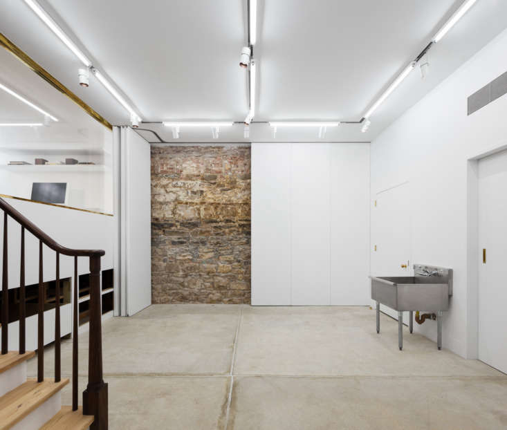 A simple but spotless basement, as seen in Layers of History--;and Color--;in an Artist Couple