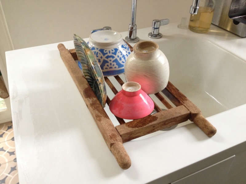 The Tornillo Wooden Dish Rack< is made from tornillo, a South American hardwood, and hooks onto the edges of the sink; $loading=