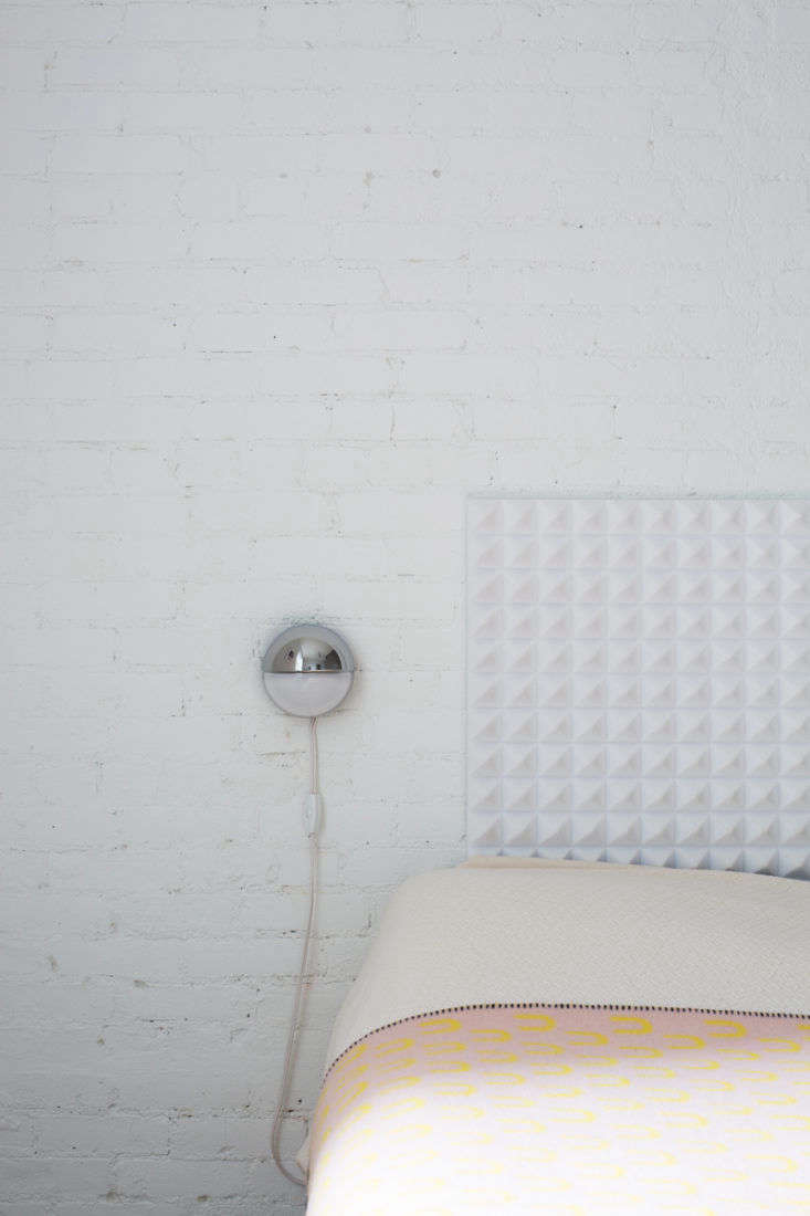 Note how the duo forwent nightstands in favor of discreet wall-mounted lights.