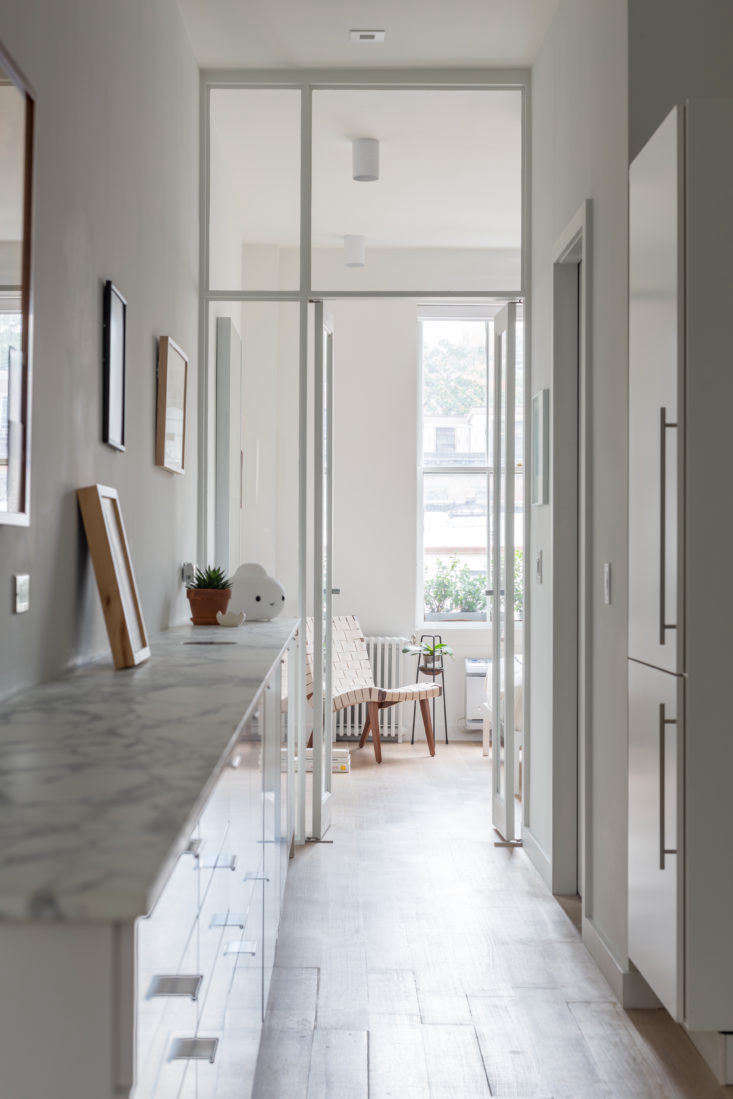 The architects opted to move all of the utilities and appliances for both the bathroom and kitchen to one side of the apartment. It&#8