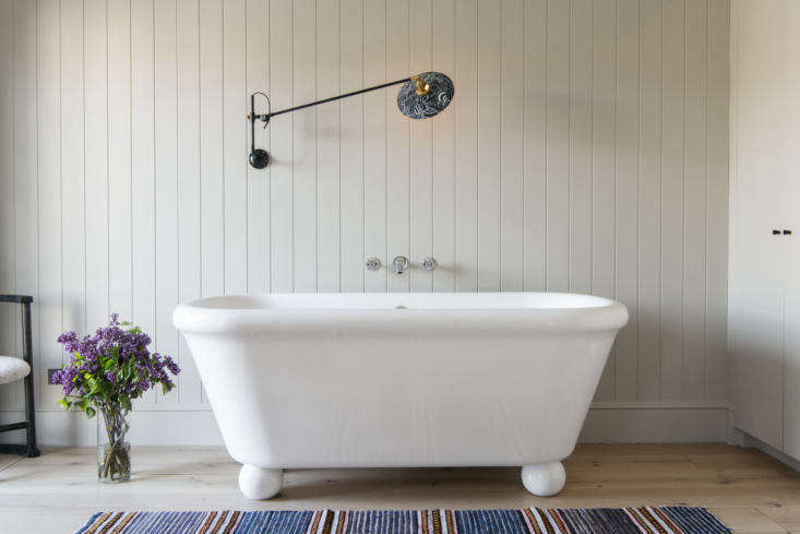 A modern freestanding tub in A Brooklyn Townhouse Reinvention from Elizabeth Roberts. (For more on the bath, see Retro Bath Fixtures from the Water Monopoly.) Photograph by Dustin Aksland.