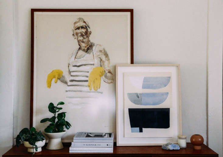 For renters, leaning artwork against the wall means no holes to patch later, and makes it easy to switch out pieces anytime.