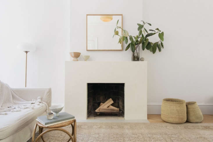 A fireplace surround treated in tadelakt. Photograph by Dustin Aksland, courtesy of Elizabeth Roberts, from A Warm, Minimalist Duplex in Brooklyn by Architect Elizabeth Roberts.