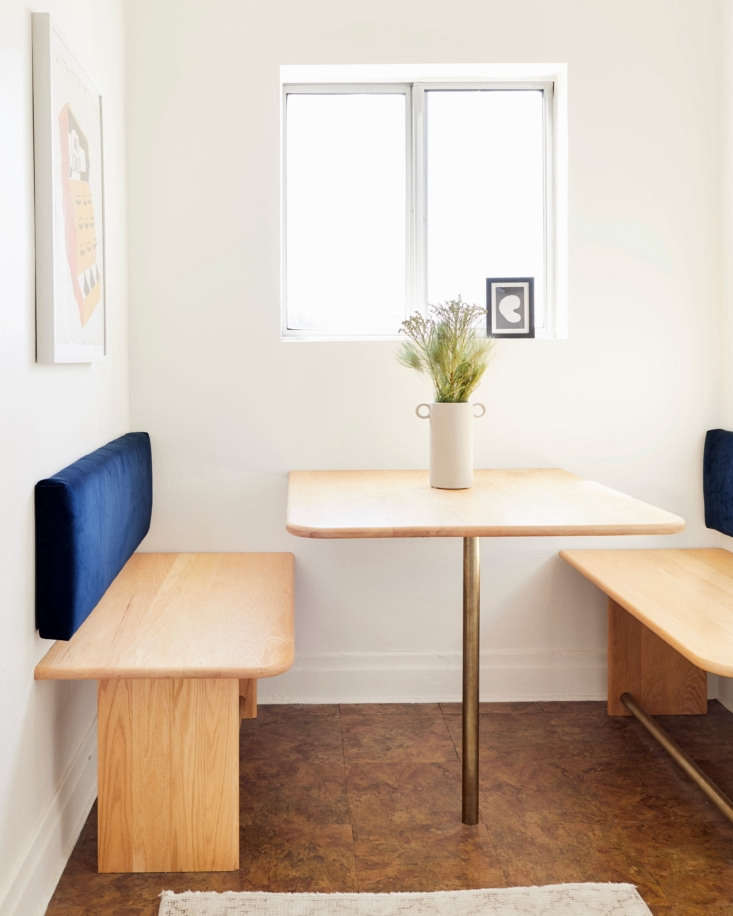 """After clearly looking at too many beautiful modern Parisian hotels and homes, I designed this guy,"" says Jessica of her breakfast nook. ""I wanted to utilize and maximize the space with a renter-friendly (minimal holes in walls) built-in instead of going for a table and chairs. This way, four people can eat at once here instead of two or maybe three."""