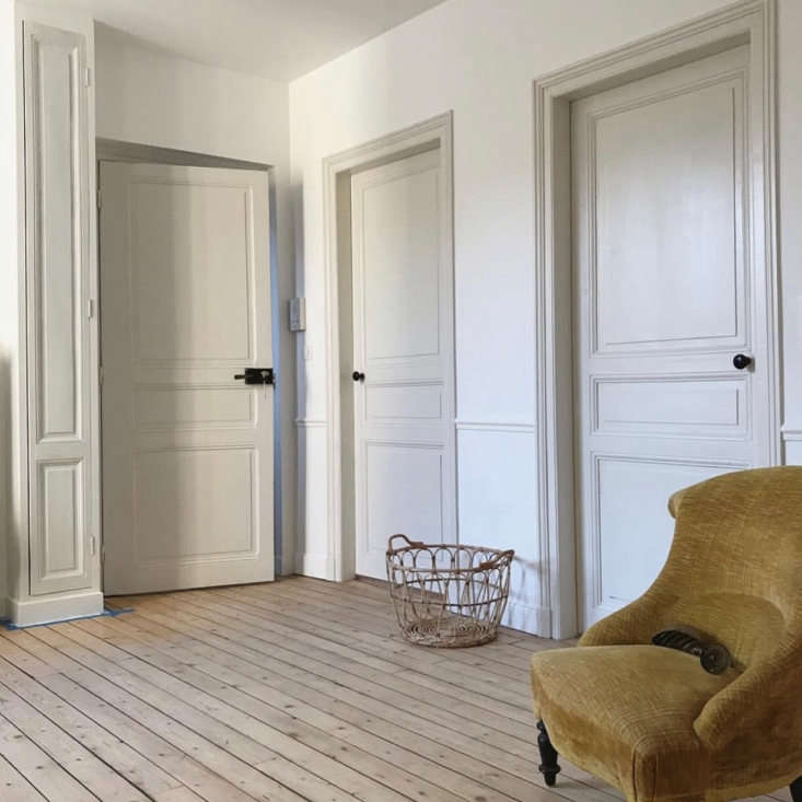 """All of the walls are painted in a velvety white,"" Brun says. The doors and woodwork are painted in Blanc de Meudon from Argile Peinture."