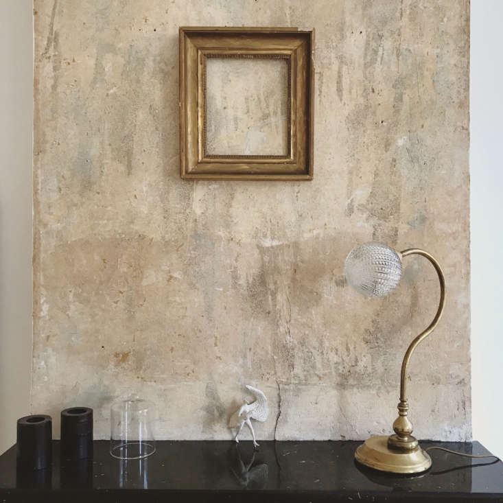 "The wall above the mantel, left intentionally unfinished. It adds, as Brun said of the project, ""the spirit of the old;"" see Trend Alert: The Excavated Look, 15 Ways for more ideas."