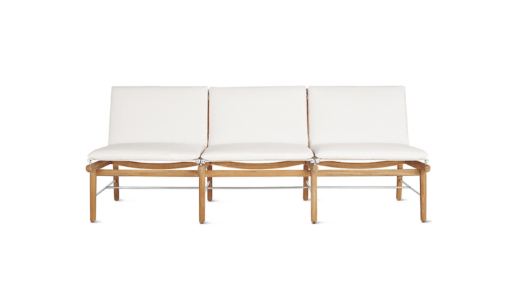 A a 76.5-inch-long Finn Three-Seater Sofa from Danish design house Norm has a teak frame and mildew-resistant Sunbrella cushions (available in white or black); $2,795 at Design Within Reach.