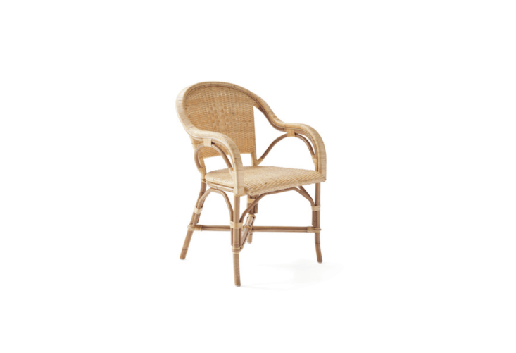 A Sunwashed Riviera Armchair available in four colors (including Natural as shown) is $358 at Serena & Lily.
