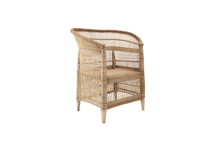 A rattan Woven Malawi Chair is made with bamboo and has a solid blue gum tree wood frame; it is $399 from CB2.
