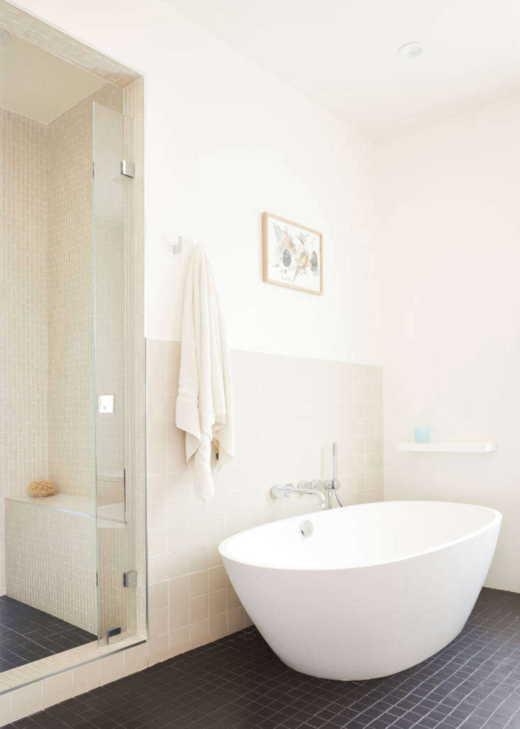 The organically-shaped freestanding tub is the Allisa from MTI.