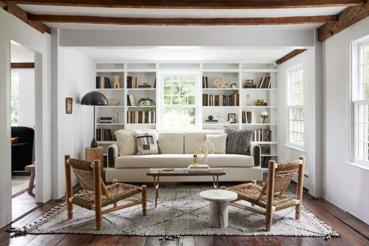 """Among the house's many attractions, according to Sheena:: """"Tons of period details and original wide plank floors."""" The Sheffield Sofa is from Fern."""