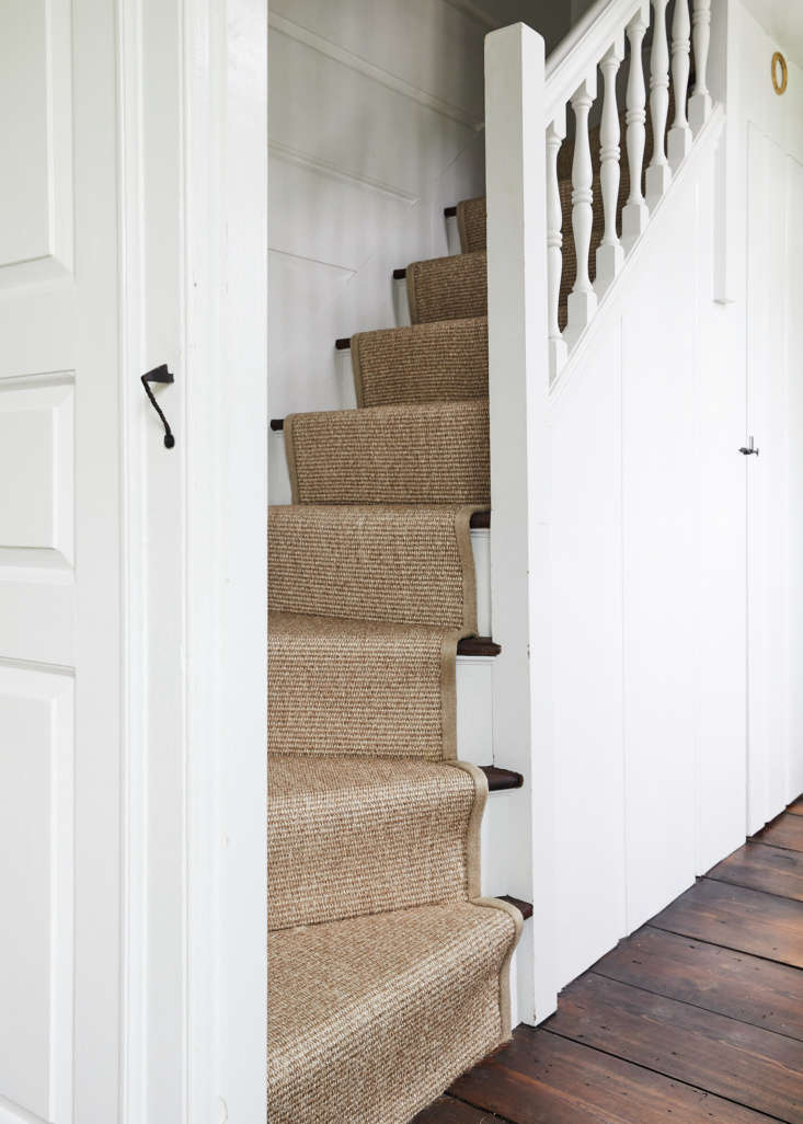 A narrow stairway leads to the second floor, which has four bedrooms.
