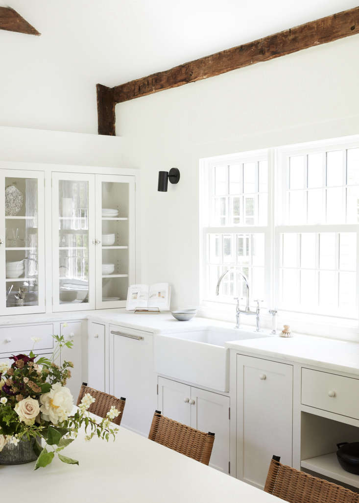 In the kitchen, theEduard Sconces are from Schoolhouse and the Parq Deck-Mounted Bridge Faucet is from Kohler.