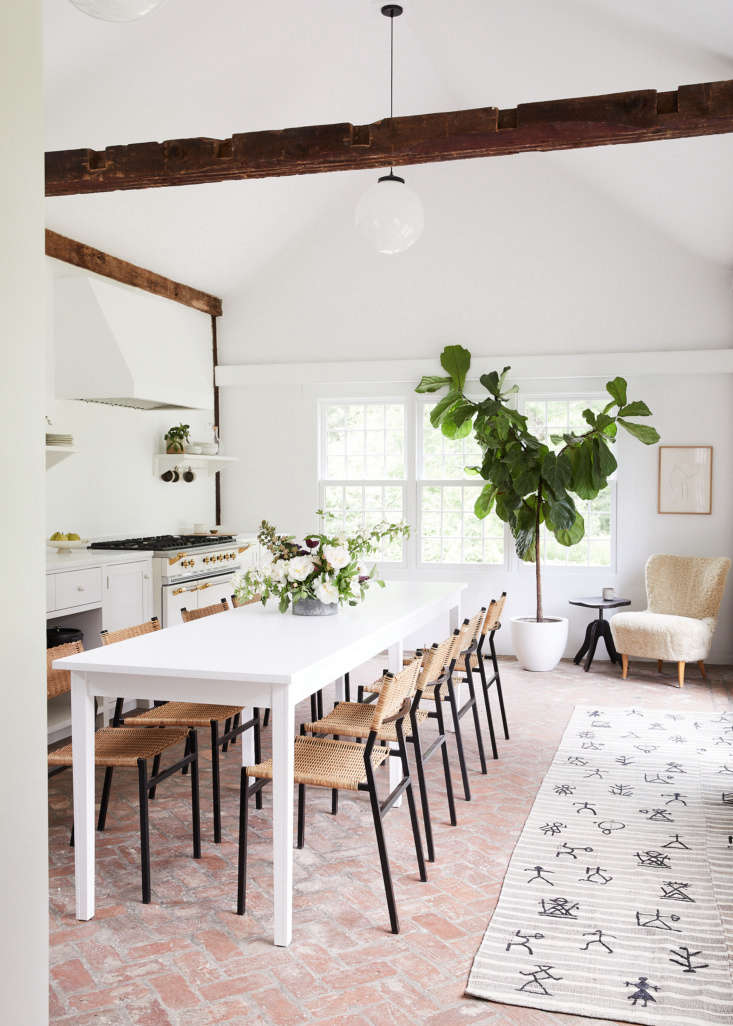 """""""We collaborated with architectural designers Frances Mildred on the kitchen renovation, which is anchored by a Table Blanche by Ann Demeulemeester and dining chairs from Amsterdam Modern,"""" Sheena says."""