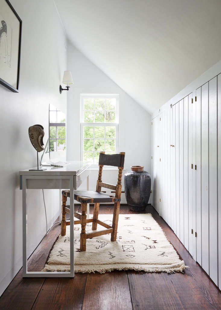 A narrow space under the eaves serves as a home office.