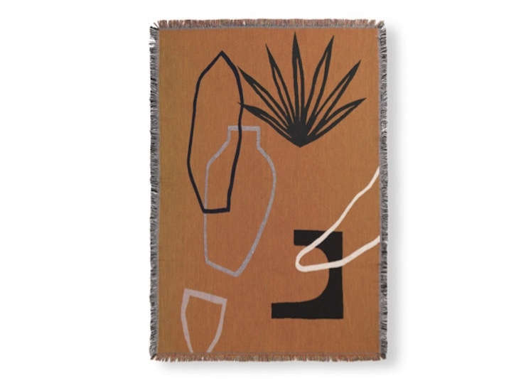 Ferm Living's cotton Mirage Blanket comes in three colors (shown is mustard); €135.