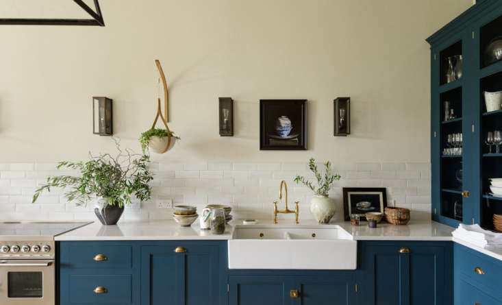 Forming a low backsplash are deVOL's Crackle Metro Tiles. The countertop is Silestone. (Love art in the kitchen? See The New Art Gallery: 12 Favorite Kitchens with Paintings on Display.)