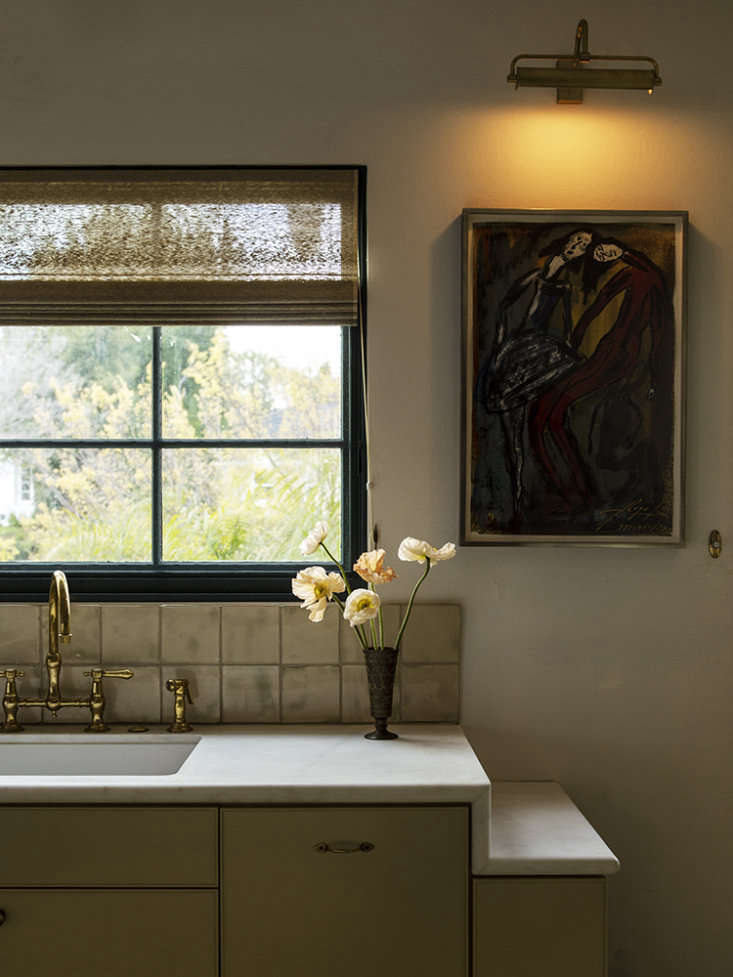 This kitchen for an LA architect features an integrated shelf for depositing mail. Photograph by Laure Joliet, courtesy of Reath Design, from LA Autumnal: A \19\20s House Makeover Composed in Jewel Tones. For a breakdown of all the storage features in this kitchen, see Sophisticated Storage: 7 Ideas to Steal from an Architect's Elegant Kitchen.