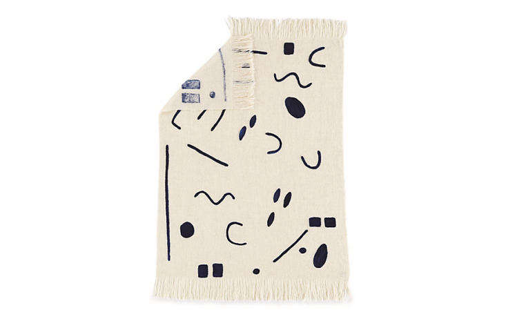 Sara Berks, founder of Minna, an online store that specializes in textiles produced in collaboration with artisans in developing countries, designed this wool Abstract Throw, which was then handwoven by a Uruguayan women's cooperative; $350 at DWR. (It's also available in different colors at Food52.)