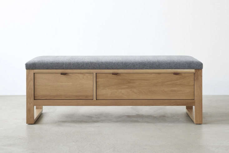 At Unison Home, the Fulton Charcoal Storage Bench is made of solid white oak with an upholstered seat; $1,599.